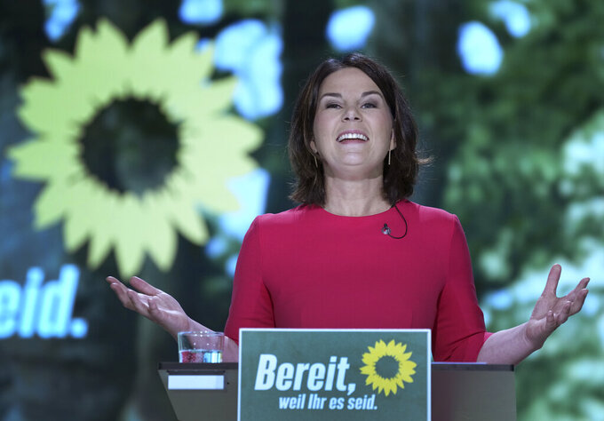 Germany's Green Party co-chairwoman Annalena Baerbock delivers a speech after beeing nominated as the party's chancellor candidate during a party convention of the Green Party in Berlin, Germany, Saturday, June 12, 2021. Slogan reads 'ready, because you are'. (AP Photo/Michael Sohn, pool)