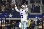 Dallas Cowboys quarterback Dak Prescott (4) celebrates after making a touchdown throw against the Washington Redskins during the second half of an NFL football game in Arlington, Texas, Sunday, Dec. 15, 2019. Prescott connected with wide receiver Michael Gallup for the touchdown. (AP Photo/Ron Jenkins)