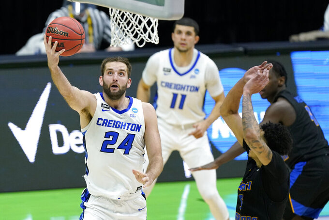 Creighton's Mitch Ballock (24) drives to the basket against UC Santa Barbara during the second half of a college basketball game in the first round of the NCAA tournament at Lucas Oil Stadium in Indianapolis Saturday, March 20, 2021. (AP Photo/Mark Humphrey)
