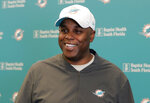FILE - In this April 17, 2019, file photo, Miami Dolphins general manager Chris Grier speaks during a news conference during voluntary minicamp at the Dolphins NFL football training facility in Davie, Fla. The Dolphins have already been busy in the draft, even though it has not started yet. (AP Photo/Lynne Sladky, File)