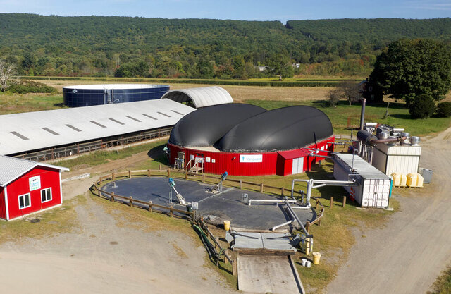 This September 2019 image provided by Vanguard Renewables shows a Farm Powered anaerobic digester facility in Deerfield, Mass. Dominion Energy is launching a $200 million effort to convert methane from cow manure into natural gas. (Chris Spencer/Vanguard Renewables via AP)