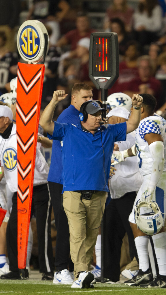 Kentucky head coach Mark Stoops celebrates the victory after an NCAA college football game against South Carolina Saturday, Sept. 25, 2021 at Williams-Brice Stadium in Columbia, S.C. (AP Photo/Hakim Wright Sr.)