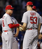 St. Louis Cardinals manager Mike Shildt, left, talks with relief pitcher John Gant during the sixth inning of a baseball game against the Chicago Cubs, Sunday, May 5, 2019, in Chicago. (AP Photo/Nam Y. Huh)
