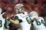 South Florida quarterback Cade Fortin (6) passes against North Carolina State during the first half of an NCAA college football game in Raleigh, N.C., Thursday, Sept. 2, 2021. (AP Photo/Gerry Broome)