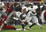 UCF running back Adrian Killins Jr. (9) looks for some running room against the Florida Atlantic defense during the first half of an NCAA college football game Saturday, Sept. 7, 2019, in Boca Raton, Fla. (AP Photo/Jim Rassol)