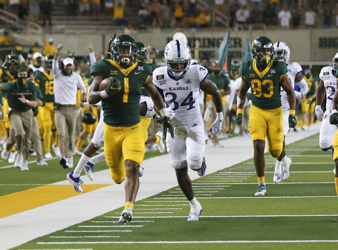 Baylor running back Trestan Ebner, left, scores past Kansas safety Nate Betts in the second half of an NCAA college football game, Saturday, Sept. 26, 2020, in Waco, Texas. (Rod Aydelotte/Waco Tribune Herald via AP)