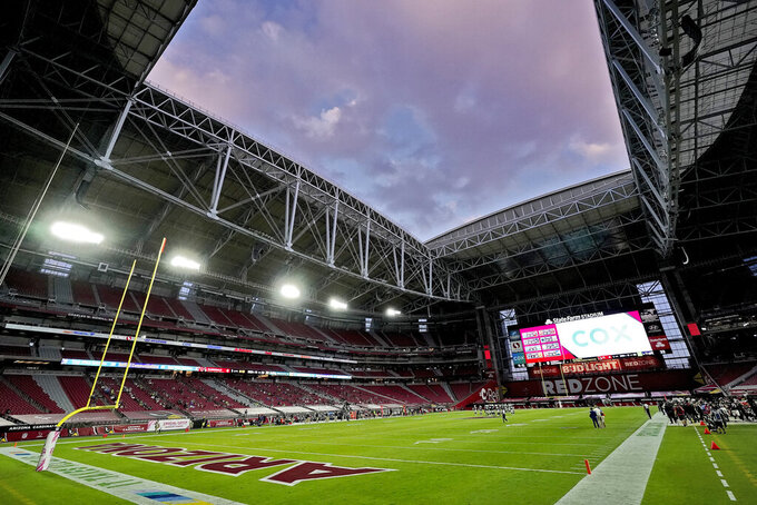 FILE - In this Oct. 25, 2020, file photo, the shows the interior of State Farm Stadium during a Seattle Seahawks and the Arizona Cardinals NFL football game in Glendale, Ariz. Governor Doug Ducey and the Arizona Department of Health Services announced Friday, Jan. 8, 2021, that Arizona will open a 24/7 vaccination site Monday at State Farm Stadium to dramatically expand the availability of COVID-19 vaccine doses in the Phoenix metropolitan area. (AP Photo/Ross D. Franklin, File)