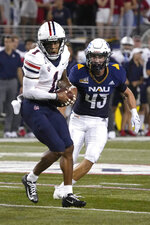Arizona wide receiver Stanley Berryhill makes the catch in front Northern Arizona defensive back Brady Shough (43) during the first half of an NCAA college football game, Saturday, Sept. 18, 2021, in Tucson, Ariz. (AP Photo/Rick Scuteri)