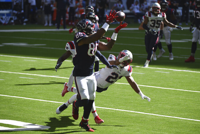 Houston Texans tight end Jordan Akins (88) makes a catch past New England Patriots strong safety Adrian Phillips (21) during the first half of an NFL football game, Sunday, Nov. 22, 2020, in Houston. (AP Photo/Eric Christian Smith)