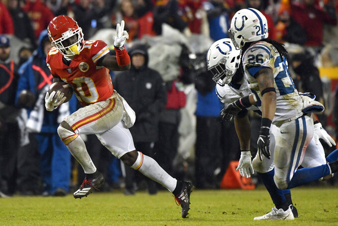 FILE - In this Jan. 12, 2019, file photo, Kansas City Chiefs wide receiver Tyreek Hill (10) gestures as he runs past Indianapolis Colts safety Clayton Geathers (26) and linebacker Anthony Walker during the second half of an NFL divisional football playoff game in Kansas City, Mo. Two-time All-Pro tight end Kelce was spectacular, setting career highs in catches (103), yards receiving (1,336) and touchdowns (10) last season. (AP Photo/Ed Zurga, File)
