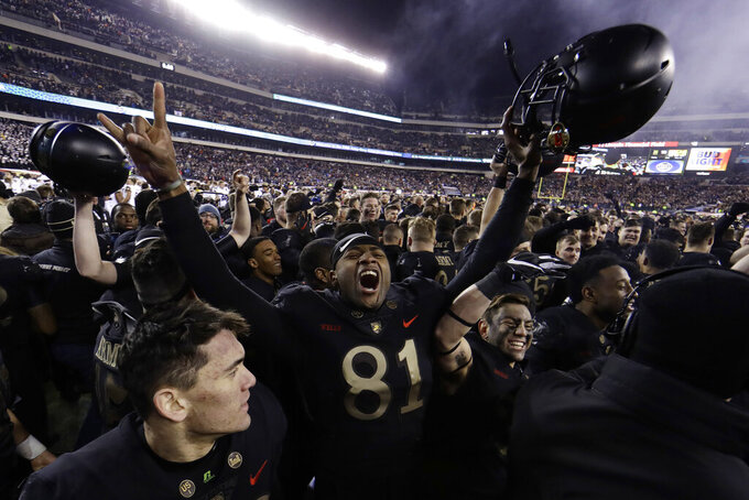 FILE - In this Dec. 8, 2018, file photo, Army's Ke'Shaun Wells celebrates after an NCAA college football game against Navy, in Philadelphia.  Army is coming off a year like no other in the storied history of the football program. (AP Photo/Matt Slocum, File)
