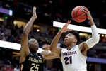 Gonzaga forward Rui Hachimura, right, shoots over Florida State forward Mfiondu Kabengele during the first half an NCAA men's college basketball tournament West Region semifinal Thursday, March 28, 2019, in Anaheim, Calif. (AP Photo/Jae C. Hong)