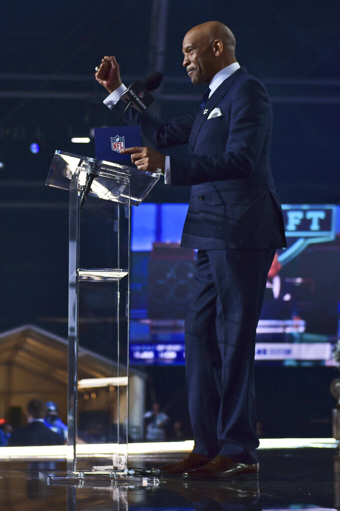Former Dallas Cowboys player Drew Pearson announces Kentucky cornerback Kelvin Joseph as the team's pick during the second round of the NFL football draft Friday, April 30, 2021, in Cleveland. (AP Photo/David Dermer)