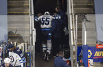 Winnipeg Jets' Mark Scheifele leaves the ice with an injury during the first period of the team's NHL hockey playoff game against the Calgary Flames in Edmonton, Alberta, Saturday, Aug. 1, 2020. (Jason Franson/The Canadian Press via AP)