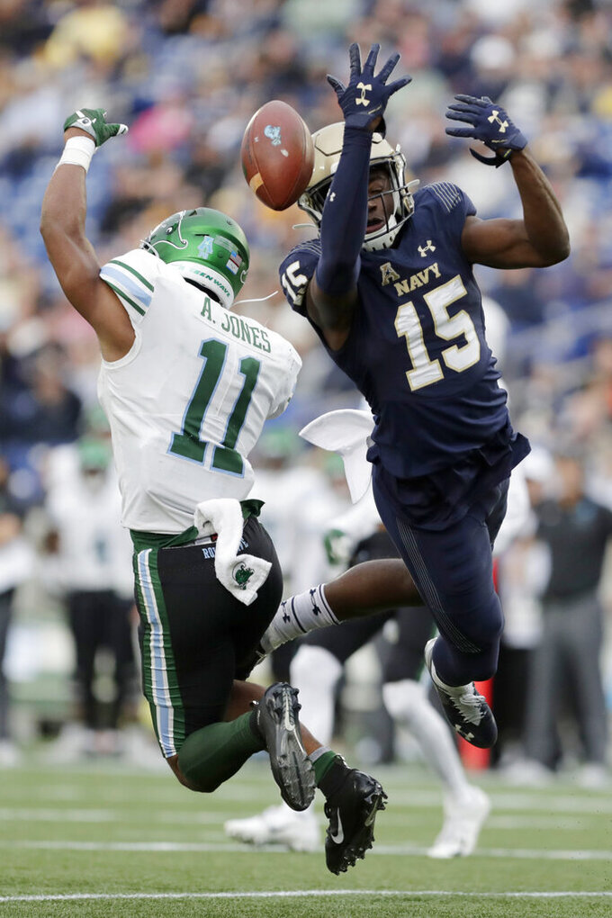 Navy safety Noruwa Obanor (15) breaks up a pass from Tulane quarterback Justin McMillan, not visible, intended for running back Amare Jones (11) during the first half of an NCAA college football game, Saturday, Oct. 26, 2019, in Annapolis. (AP Photo/Julio Cortez)