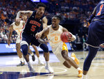 Tennessee's Jordan Bone (0) heads to the basket as Auburn's Chuma Okeke (5) defends in the second half of the NCAA college basketball Southeastern Conference championship game Sunday, March 17, 2019, in Nashville, Tenn. (AP Photo/Mark Humphrey)