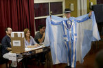 A man shows off his Argentine flag motif suit and cape before voting in Buenos Aires, Argentina, Sunday, Oct. 27, 2019. Argentina could take a political turn in Sunday's presidential elections, with center-left Peronist candidate Alberto Fernández favored to oust conservative incumbent Mauricio Macri amid growing frustration over the country's economic crisis. (AP Photo/Daniel Jayo)