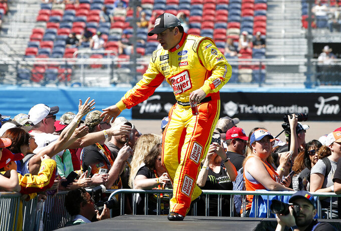 Ryan Newman is greeted by fans during driver introductions prior to the start of the NASCAR Cup Series auto race at ISM Raceway, Sunday, March 10, 2019, in Avondale, Ariz. (AP Photo/Ralph Freso)