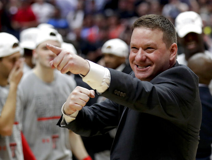 FILE - In this March 30, 2019, file photo, Texas Tech head coach Chris Beard celebrates after the team's win against Gonzaga during the West Regional final in the NCAA men's college basketball tournament, in Anaheim, Calif. Beard was named The Associated Press Coach of the Year, Thursday, April 4, 2019. (AP Photo/Marcio Jose Sanchez, File)