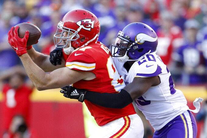 Kansas City Chiefs tight end Travis Kelce (87) makes a catch against Minnesota Vikings cornerback Mackensie Alexander (20) during the second half of an NFL football game in Kansas City, Mo., Sunday, Nov. 3, 2019. (AP Photo/Colin E. Braley)
