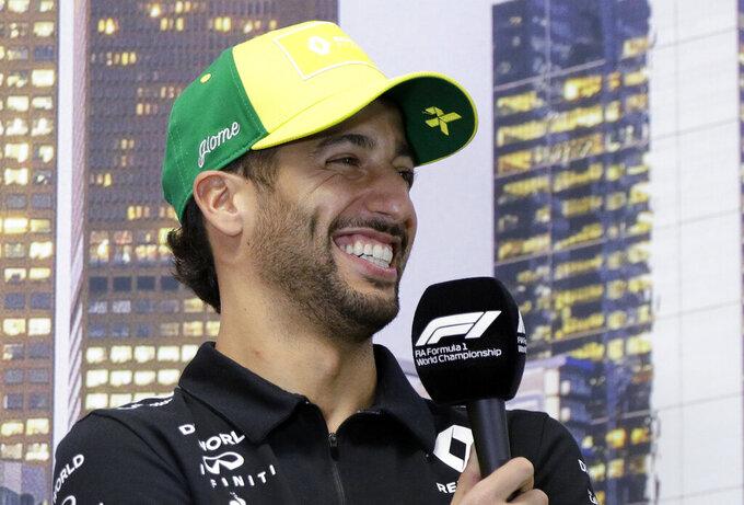 Renault driver Daniel Ricciardo of Australia laughs during a press conference at the Australian Formula One Grand Prix in Melbourne, Thursday, March 12, 2020. (AP Photo/Rick Rycroft)