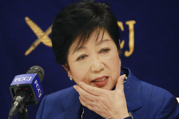 Tokyo Gov. Yuriko Koike speaks during a news conference in Tokyo, Tuesday, Nov. 24, 2020. Koike remains firm about being able to safely hold the Olympics next year despite growing concerns about Japan's recent resurgence of COVID-19 infections. (AP Photo/Koji Sasahara)