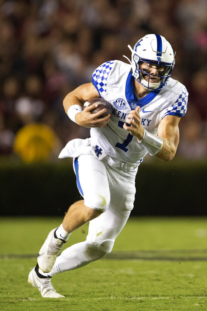 Kentucky quarterback Will Levis (7) runs with the ball in the second half of an NCAA college football game against South Carolina, Saturday, Sept. 25, 2021, at Williams-Brice Stadium in Columbia, S.C. (AP Photo/Hakim Wright Sr.)