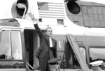 FILE - In this Aug. 9, 1974 file photo, President Richard Nixon waves goodbye from the steps of his helicopter outside the White House, after he gave a farewell address to members of the White House staff. Nixon was taken to nearby Andrews Air Force Base where he boarded Air Force One for a flight to California. On Aug. 7, 1974, three top Republican leaders in Congress paid a solemn visit to Nixon at the White House, bearing the message that he faced near-certain impeachment due to eroding support in his own party on Capitol Hill. Nixon, who'd been entangled in the Watergate scandal for two years, announced his resignation the next day. (AP Photo/Chick Harrity)