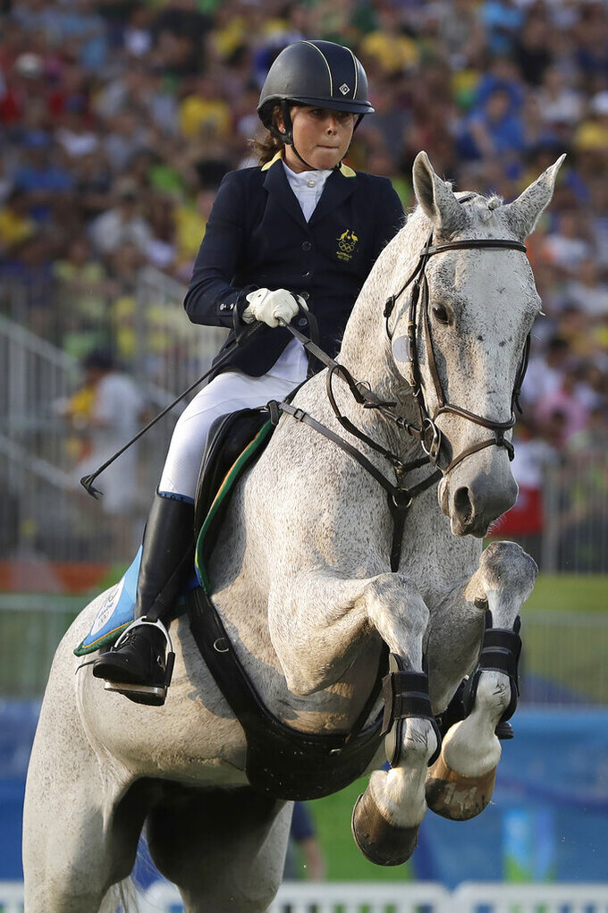"""FILE - In this Aug. 19, 2016, file photo, gold medal winner Chloe Esposito of Australia competes in the equestrian portion of the women's modern pentathlon at the Summer Olympics in Rio de Janeiro, Brazil. Esposito announced in late January that a """"wonderful, unexpected surprise"""" had occurred and that the Australian wouldn't be able to defend her modern pentathlon gold medal at the Tokyo Olympics. She was pregnant with her first child. Two months later Esposito and thousands of other Olympic athletes learned that the Tokyo Games would be put off by a year until July 2021 because of the coronavirus pandemic. While for some it meant more time to recover from injuries or extra time to prepare, Esposito realized it might give her a second chance to be in Tokyo next year. (AP Photo/Kirsty Wigglesworth, File)"""