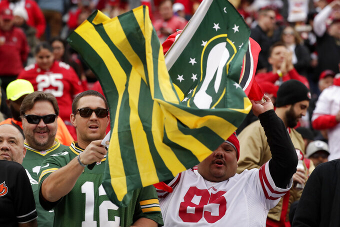 Fans cheer during warms up before the NFL NFC Championship football game between the San Francisco 49ers and the Green Bay Packers Sunday, Jan. 19, 2020, in Santa Clara, Calif. (AP Photo/Matt York)