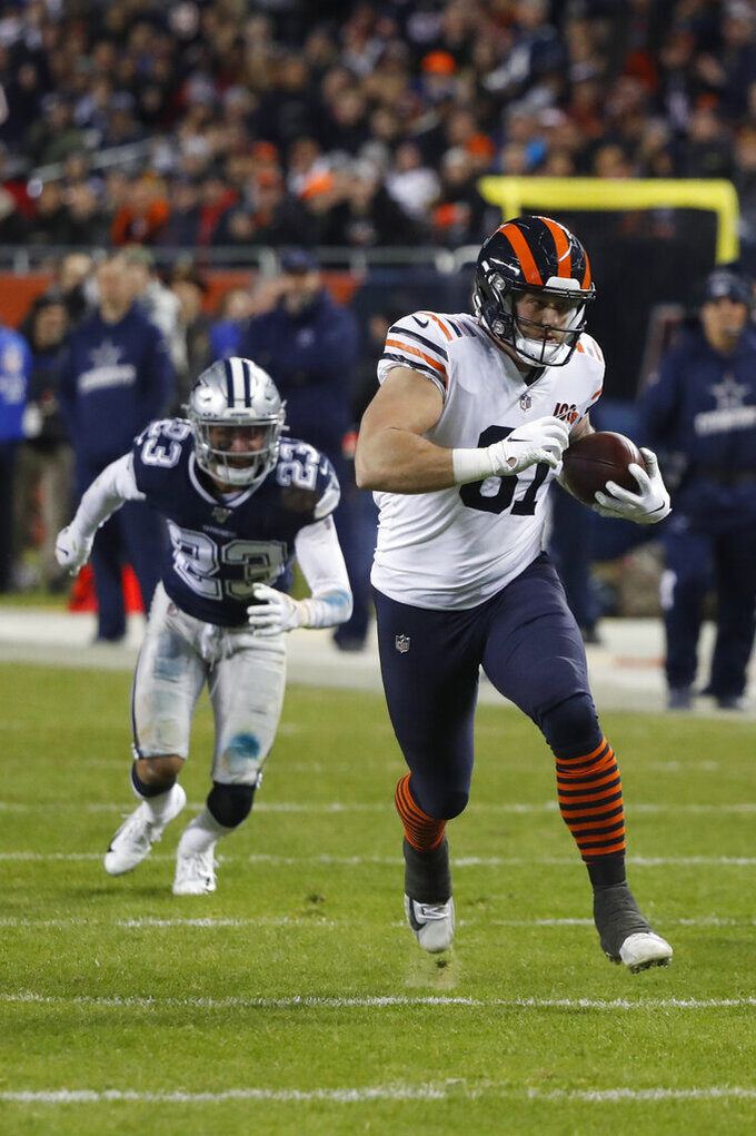 Chicago Bears' J.P. Holtz (81) is chased by Dallas Cowboys' Darian Thompson (23) during the first half of an NFL football game, Thursday, Dec. 5, 2019, in Chicago. (AP Photo/Charles Rex Arbogast)