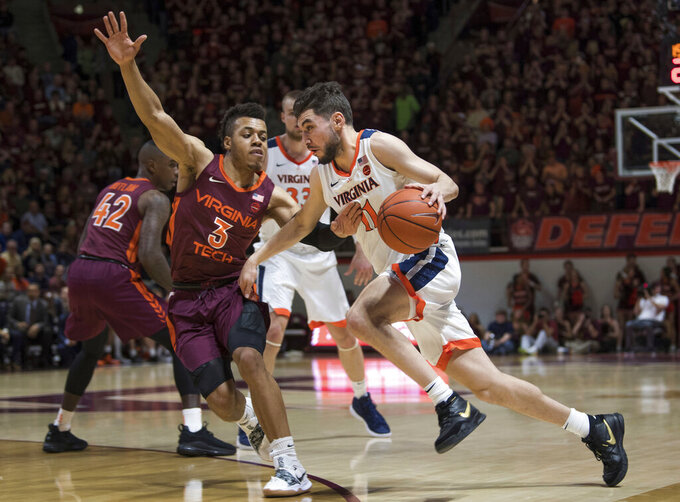 Guy's 23 lift No. 3 Virginia past No. 20 Hokies, 64-58