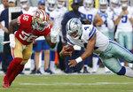 Dallas Cowboys quarterback Dak Prescott (4) dives in front of San Francisco 49ers linebacker Reuben Foster (56) during the first half of an NFL preseason football game in Santa Clara, Calif., Thursday, Aug. 9, 2018. (AP Photo/Josie Lepe)
