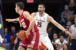 Illinois forward Giorgi Bezhanishvili (15) defends against Wisconsin forward Ethan Happ (22) during the first half of an NCAA college basketball game in Champaign, Ill., Wednesday, Jan. 23, 2019. (AP Photo/Stephen Haas)