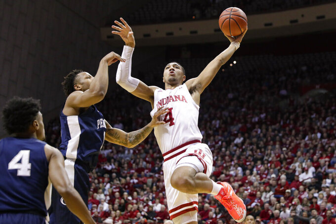 Indiana forward Trayce Jackson-Davis (4) shoots over Penn State forward Seth Lundy (1) in the first half of an NCAA college basketball game in Bloomington, Ind., Sunday, Feb. 23, 2020. (AP Photo/Michael Conroy)