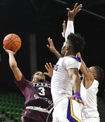 Prairie View A&M forward Iwin Ellis (13) defends a shot by Texas Southern guard Jalyn Patterson (3) during the first half of the SWAC championship NCAA college basketball game Saturday, March 16, 2019, in Birmingham, Ala. (AP Photo/Julie Bennett)