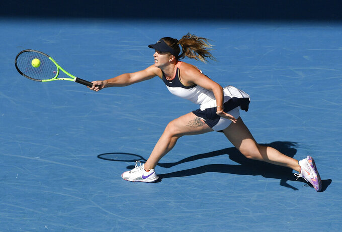 Ukraine's Elina Svitolina hits a forehand return to United States' Jessica Pegula during their fourth round match at the Australian Open tennis championship in Melbourne, Australia, Monday, Feb. 15,2021.(AP Photo/Andy Brownbill)