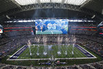 FILE - In this Jan. 3, 2016, file photo, the Dallas Cowboys jog onto the field at the start of an NFL football game against the Washington Redskins at AT&T Stadium in Arlington, Texas. The first stadium with construction costs that passed the $1 billion price tag, AT&T Stadium opened for the Cowboys for the 2009 season in the suburb of Arlington with a massive, center-hung, high-definition videoboard as the premier attraction among many Texas-sized amenities.(AP Photo/Roger Steinman, File)