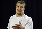 FILE - In this Nov. 28, 2018, file photo, New England Patriots tight end Rob Gronkowski speaks to the media after an NFL football practice  in Foxborough, Mass. Gronkowski will be in Miami for the Super Bowl. He will not be preparing for kickoff with Tom Brady and the rest of his old New England teammates. Instead, the man who retired from the Patriots and the NFL in March will be hosting his first Super Bowl party. (AP Photo/Steven Senne, File)