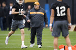 In this Thursday, March 7, 2019 photo, Tennessee offensive coordinator Jim Chaney walks on the field during Tennessee football's first practice of the spring season in Knoxville, Tenn. Tennessee is opening spring practice with its fourth offensive coordinator in as many seasons as it tries to rejuvenate an attack that ranked last in the Southeastern Conference in yards per game the last two years. (Caitie McMekin/Knoxville News Sentinel via AP)