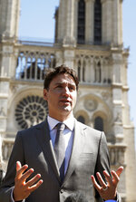 Canadian Prime Minister Justin Trudeau adresses reporters after visiting Notre Dame cathedral in Paris, Wednesday, May 15, 2019. Trudeau is in Paris for a meeting with World leaders and tech bosses to make a joint push to eliminate acts of violent extremism from being shown online. (AP Photo/Christophe Ena)