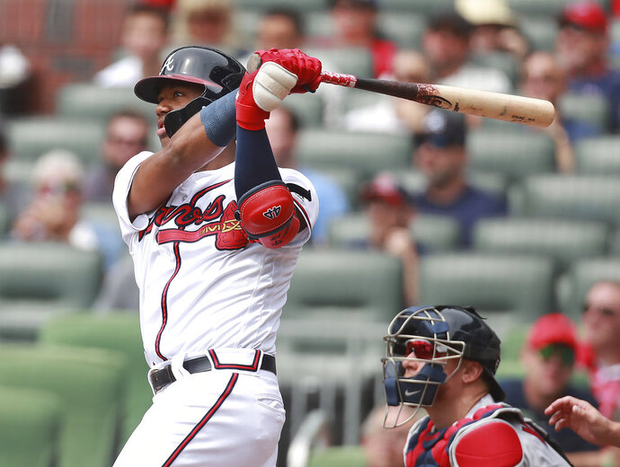 Atlanta Braves' Ronald Acuna Jr. hits a lead off homer against the Boston Red Sox during the first inning of a baseball game in Atlanta, Wednesday, Sept 5, 2018, in Atlanta. (Curtis Compton/Atlanta Journal-Constitution via AP)