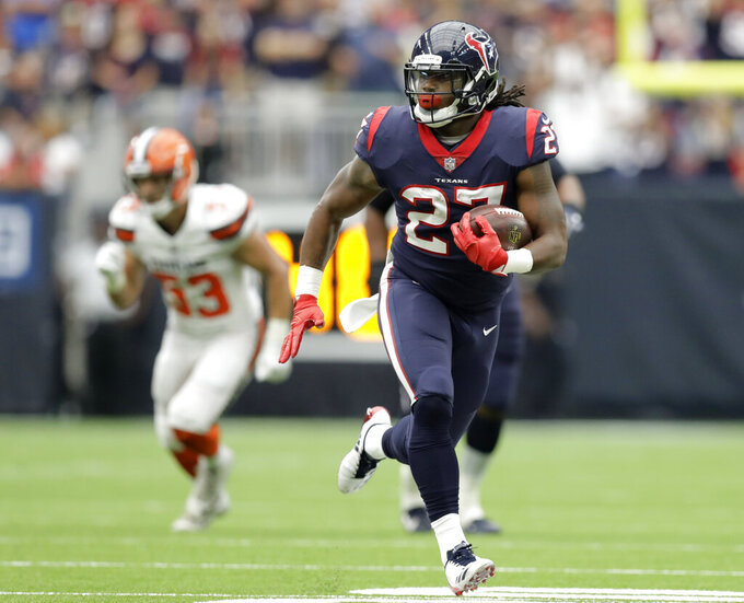 FILE - In this Sunday, Oct. 15, 2017 file photo, Houston Texans running back D'Onta Foreman (27) breaks out for a long run against the Cleveland Browns in the first half of an NFL football game in Houston. Two days after being cut by the Texans, the third-year running back made it onto the field in suburban Indianapolis eager to prove he can still play in the NFL. (AP Photo/Eric Gay, File)