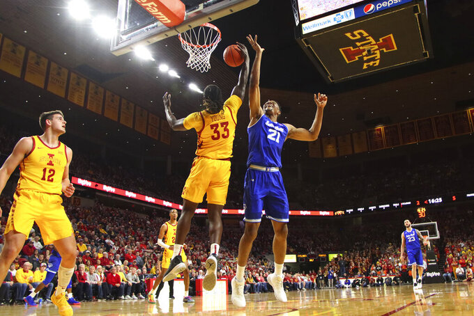 Iowa State forward Solomon Young, center, pulls down a rebound in front of Seton Hall center Ike Obiagu, right, during the first half of an NCAA college basketball game, Sunday, Dec. 8, 2019, in Ames, Iowa. (AP Photo/Matthew Putney)