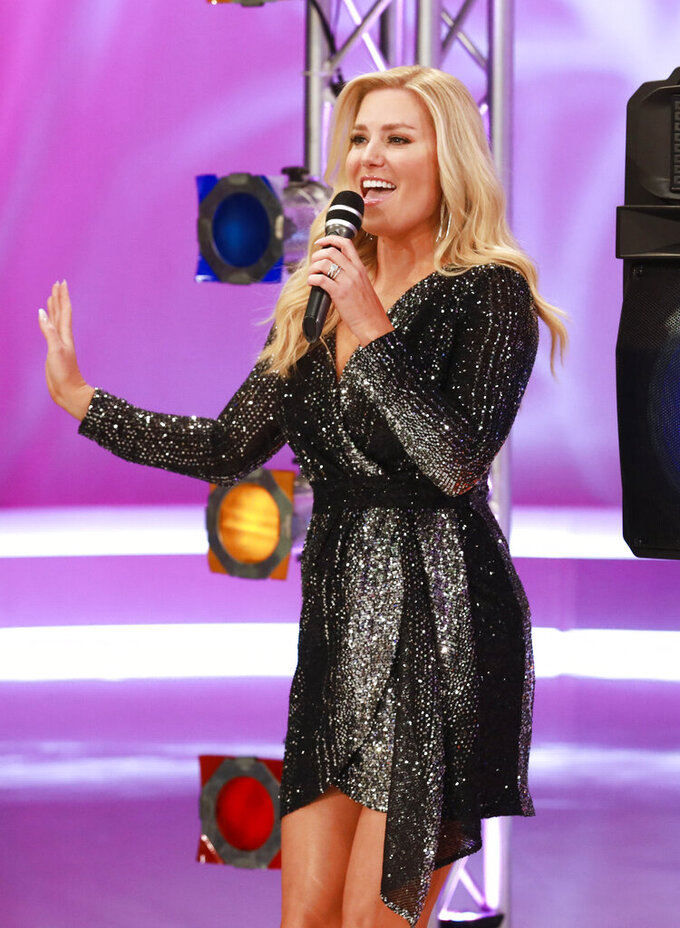 """This image released by CBS Entertainment shows Rachel Reynolds on the set of """"The Price is Right,"""" in Los Angeles. The longest-running game show in television history is celebrating it's 50th season. (Sonja Flemming/CBS via AP)"""