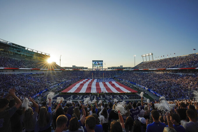 A large American Flag is stretched across the Kroger Field prior to an NCAA college football game between Kentucky and Eastern Michigan, Saturday, Sept. 7, 2019, in Lexington, Ky. (AP Photo/Bryan Woolston)