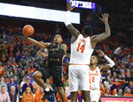 Florida State's David Nichols, left, drives to the basket while defended by Clemson's Elijah Thomas, right, during the first half of an NCAA college basketball game Tuesday, Feb. 19, 2019, in Clemson, S.C. (AP Photo/Richard Shiro)