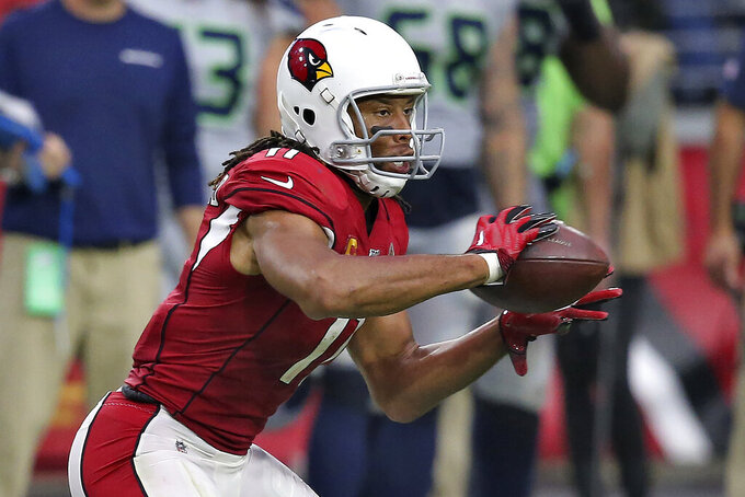 Arizona Cardinals wide receiver Larry Fitzgerald (11) catches his career 1,326 catch to pass Tony Gonzalez for second place on the all-time receptions list during the second half of an NFL football game against the Seattle Seahawks, Sunday, Sept. 29, 2019, in Glendale, Ariz. (AP Photo/Ross D. Franklin)