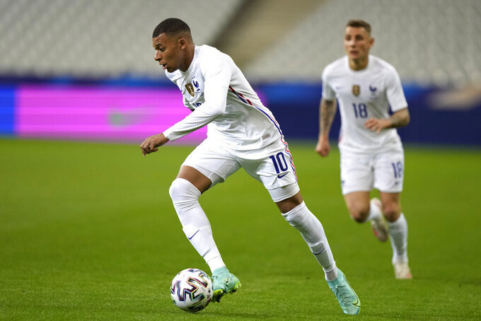 France's Kylian Mbappe controls the ball during the international friendly soccer match between France and Bulgaria at the Stade De France in Saint Denis, North of Paris, France, Tuesday, June 8, 2021. (AP Photo/Francois Mori)