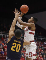 Stanford forward KZ Okpala, right, shoots against California guard Matt Bradley (20) during the first half of an NCAA college basketball game in Stanford, Calif., Thursday, March 7, 2019. (AP Photo/Jeff Chiu)